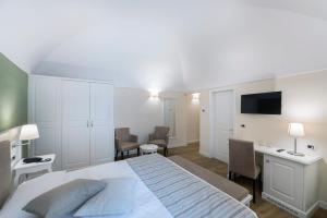 Hotel Garni Corona, Отели  Менаджо - big - 11