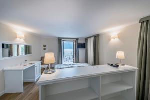 Hotel Garni Corona, Отели  Менаджо - big - 58
