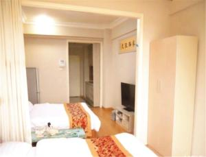 Dalian Development Zone Zuoan Jingdian Shishang Apartment, Apartmány  Jinzhou - big - 5