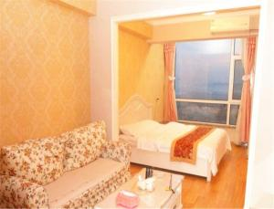 Dalian Development Zone Zuoan Jingdian Shishang Apartment, Apartmány  Jinzhou - big - 4