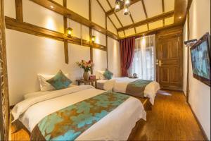 Lijiang Riverside Inn, Penziony  Lijiang - big - 24