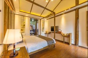 Lijiang Riverside Inn, Penziony  Lijiang - big - 11