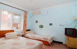Xinghaige Guesthouse, Alloggi in famiglia  Qinhuangdao - big - 6