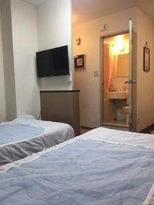 Naniwa Guest House Kuromon, Apartmanok  Oszaka - big - 25