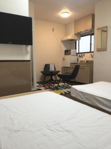 Naniwa Guest House Kuromon, Apartmanok  Oszaka - big - 24