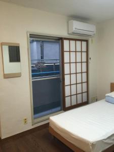 Naniwa Guest House Kuromon, Apartmanok  Oszaka - big - 23