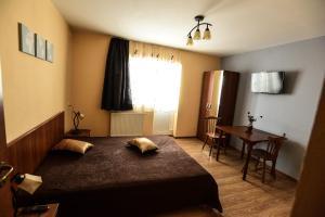 Pensiunea Casa Diaspora, Отели типа «постель и завтрак»  Тыргу-Жиу - big - 10