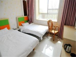 Kelinning Hotel Qingdao East Jialingjiang Road, Szállodák  Huangtao - big - 4