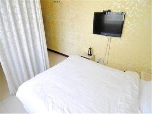 Kelinning Hotel Qingdao East Jialingjiang Road, Szállodák  Huangtao - big - 12