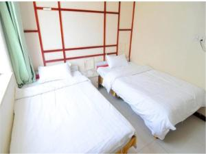 Kelinning Hotel Qingdao East Jialingjiang Road, Szállodák  Huangtao - big - 2