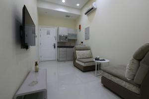 Dorrah Suites, Aparthotels  Riad - big - 15