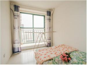 Qingdao Golden Beach Sihaiju Seaview Apartment Hai'an Fengqing Branch, Apartmanok  Huangtao - big - 4