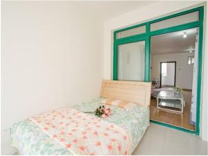 Qingdao Golden Beach Sihaiju Seaview Apartment Hai'an Fengqing Branch, Apartmanok  Huangtao - big - 6