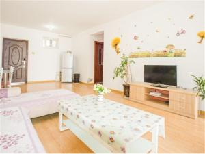 Qingdao Golden Beach Sihaiju Seaview Apartment Hai'an Fengqing Branch, Apartmanok  Huangtao - big - 5