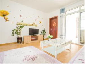 Qingdao Golden Beach Sihaiju Seaview Apartment Hai'an Fengqing Branch, Apartmanok  Huangtao - big - 3