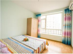 Qingdao Golden Beach Sihaiju Seaview Apartment Hai'an Fengqing Branch, Apartmanok  Huangtao - big - 13