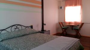 Dvoulůžkový pokoj typu Superior s manželskou postelí a vlastní koupelnou