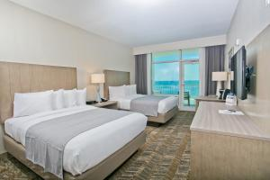 Queen Room with Two Queen Beds Bunk Bed - Beach View with Private Balcony