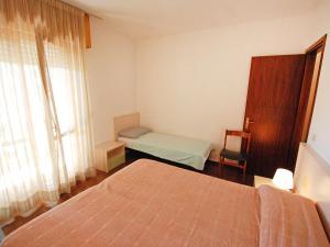 Locazione turistica Villa del Silenzio.2, Dovolenkové domy  Lignano Sabbiadoro - big - 8