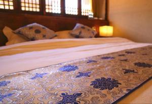 Lijiang Shuhe Qingtao Inn, Penziony  Lijiang - big - 5
