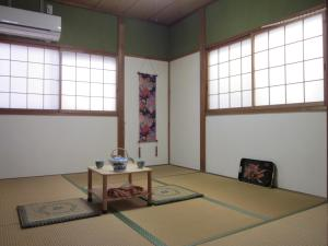 Enman Guest House Osaka, Гостевые дома  Осака - big - 3