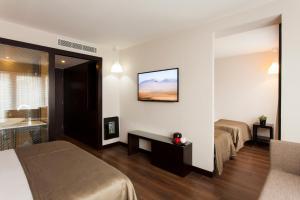 Luxury Triple Room with Balcony