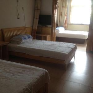 Laoshan Shengyoujia Guesthouse, Vendégházak  Csingtao - big - 1