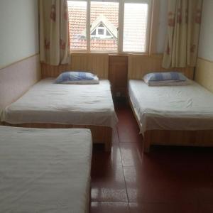 Laoshan Shengyoujia Guesthouse, Vendégházak  Csingtao - big - 15