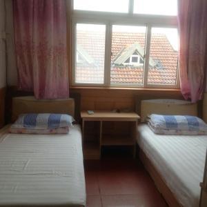 Laoshan Shengyoujia Guesthouse, Vendégházak  Csingtao - big - 16