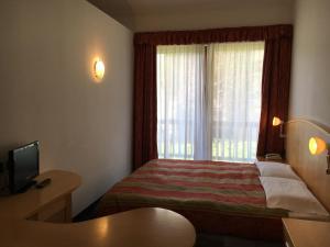 Hotel Garni Enrosadira, Hotely  Vigo di Fassa - big - 8