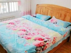 Qingdao Jinshatan Hainiu Seaside Holiday Apartment, Apartments  Huangdao - big - 7