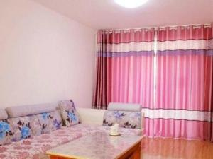 Qingdao Jinshatan Hainiu Seaside Holiday Apartment, Apartments  Huangdao - big - 8