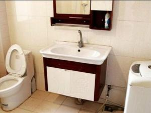 Qingdao Jinshatan Hainiu Seaside Holiday Apartment, Apartments  Huangdao - big - 9