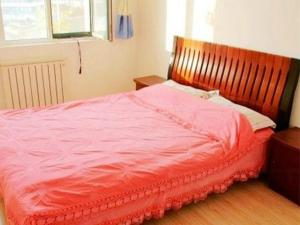 Qingdao Jinshatan Hainiu Seaside Holiday Apartment, Apartments  Huangdao - big - 10