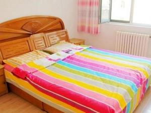 Qingdao Jinshatan Hainiu Seaside Holiday Apartment, Apartments  Huangdao - big - 12
