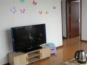 Qingdao Golden Beach Zongze Mama Homestay, Apartmány  Huangdao - big - 4