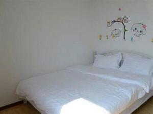 Qingdao Golden Beach Zongze Mama Homestay, Apartmány  Huangdao - big - 7