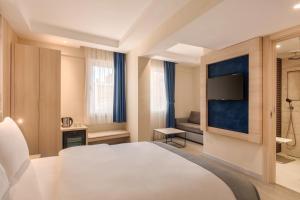 Bezbariérový pokoj s manželskou postelí velikosti King – nekuřácký