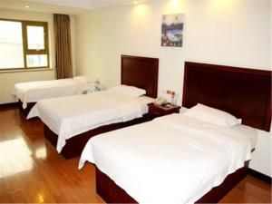 Izunco Inn Qingdao Xiangjiang Road, Отели  Huangdao - big - 9