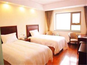 Izunco Inn Qingdao Xiangjiang Road, Отели  Huangdao - big - 6