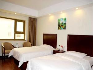 Izunco Inn Qingdao Xiangjiang Road, Отели  Huangdao - big - 5