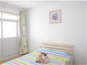 Qingdao Jinshatan Tingtao Apartment, Ferienwohnungen  Huangdao - big - 7