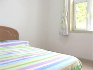 Qingdao Jinshatan Tingtao Apartment, Ferienwohnungen  Huangdao - big - 8