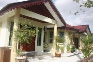 Malinja Homestay, Holiday homes  Kuah - big - 6