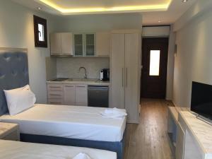Vergos Hotel, Апарт-отели  Вурвуру - big - 10