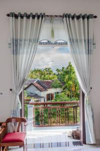 Anh Nhung Guesthouse, Penziony  Hoi An - big - 17