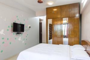 Madam Re Service Apartment - Neptune Tower - Powai, Appartamenti  Mumbai - big - 8
