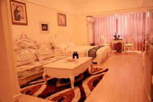 Qingdao Youjiafu Holiday Apartment Wanda Oriental Film Center, Aparthotely  Huangdao - big - 1