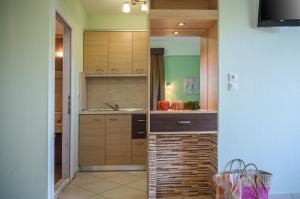 Rodon Garden, Apartments  Sarti - big - 26