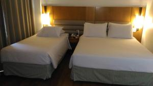 Habitación Doble Estándar - 1 cama doble y 1 cama individual